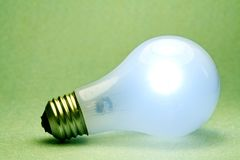 Green Light Bulb side. A shot of a glowing light bulb Royalty Free Stock Photography