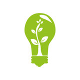Green light bulb with tree plant inside Stock Photography