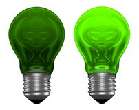 Green light bulbs, one glowing, another not Stock Photos