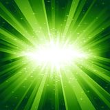 Green light burst with stars. Festive explosion of light and stars from white to dark green with centre in the middle of the square image. 7 global colors Royalty Free Stock Photo