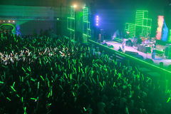 Green light in concert. Many people enjoy in concert with green light tube Stock Image