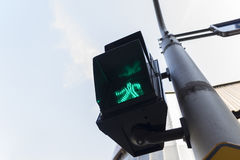Green light crossing. Green light signal for pedestrian walk across crosswalk way Royalty Free Stock Photos