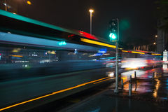Green light. A crosswalk in Alsancak. After a rainy day. Nice reflections are everywhere.A bus is passing through and effects a nice motion blur with its lights Royalty Free Stock Photography