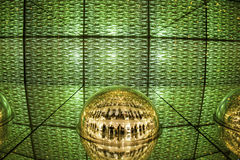 Green Light display, colored laser, mirror walls, and mirror ball, abstract background Stock Image