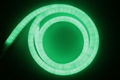 Green light of led lamp. Long thin led Lamp green color twisted in a around like eye Royalty Free Stock Images