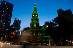 Light moving of bustling city center scene with old clock tower. Green light moving of bustling city center scene with old clock tower in Sydney stock photo