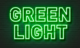 Green light neon sign. On brick wall background royalty free stock photography