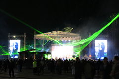 Green light night concert stage. Scottish rock vocalist Doogie White performing on the stage at Varna Sea Port and striking green laser lights during the Black Stock Photography
