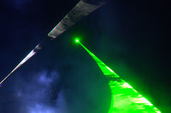Green light night concert stage. Striking green laser lights and microphone on live concert stage Royalty Free Stock Photo