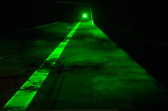 Green light night concert stage. Striking green laser lights and microphone on live concert stage Stock Photos