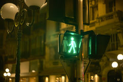Green light. Green pedestrian traffic light in a characteristic street of Nice in France Stock Photography