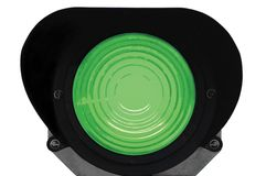 Green light railway traffic signal isolated. Green light railway traffic dwarf signal set at safe to go ahead, isolated, railroad ground mounting lamp Stock Images