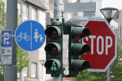 Green light and road signs Stock Photography