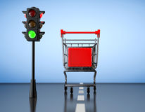 Green Light for Shopping. Shopping Cart with Traffic Light Stock Photos