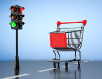 Green Light for Shopping. Shopping Cart with Traffic Light Royalty Free Stock Photo