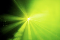 Green light on a stage at concert. Bright coloured stage light shot in a dark environment Stock Images