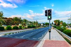 Green light on traffic light. And road Royalty Free Stock Photography
