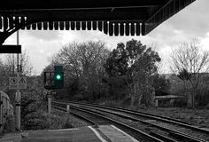 Green light at train station Stock Images