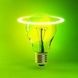 Green Lightbulb Background. A lit light bulb on green Stock Photography