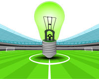 Green lightbulb in the midfield of football stadium vector Royalty Free Stock Photo