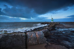 Green lighthouse in dusk on North sea Stock Photo