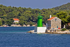 Green lighthouse - lantern in bay entrance Royalty Free Stock Photo
