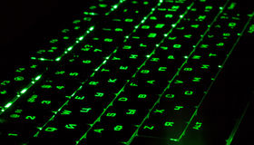 Green lighting keyboard in the dark Stock Photos