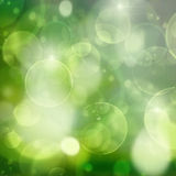 Green lights on black  festive bokeh background. Spring green on black  festive garden  bokeh background with sun beams Stock Photo