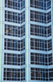 Green Lights on Blue Office tower Royalty Free Stock Image