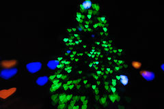 Green lights on the Christmas tree in the form of hearts blurry Royalty Free Stock Photography