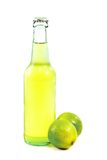 Green Lime Beer. A bottle of lime beer with lime slice on white background royalty free stock image