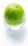 Green lime in the glass bowl Stock Photos