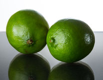 Green lime. On glass table royalty free stock photo