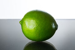 Green lime. On glass table stock photos