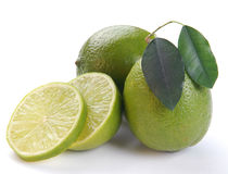 Green lime with a half. On a white background royalty free stock images