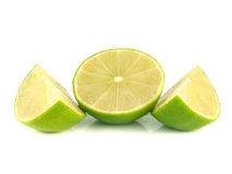 green lime half with slices on white Stock Images