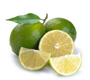 Green lime with a half. On a white background stock images