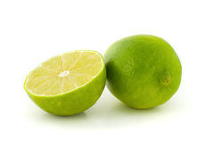 Green lime and its half Royalty Free Stock Image