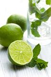 Green lime with mint. Green lime with fresh mint Stock Photo