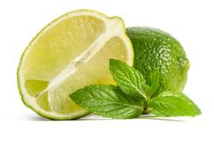 Green lime and mint with half of juicy lime. Isolated on white background stock image