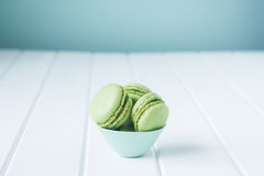 Green lime or pistachio flavored macarons in a small blue dish Royalty Free Stock Photography
