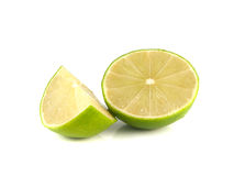 green lime with slice on white Royalty Free Stock Images