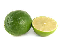 Green lime with sliced half on a white. Background. Fresh diet fruit. Healthy fruit with vitamins Stock Photography