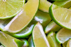 Green Lime Slices Background. With visible black background surface royalty free stock photography