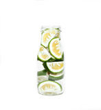 Green lime slices in a bottle. Isolated stock images