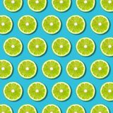 Green lime slices pattern on vibrant turquoise background royalty free stock image