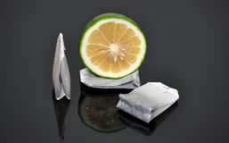 Green lime with tea bags. Isolated stock photos