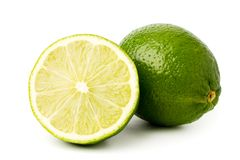 Green lime tree and half on a white. Background, close up royalty free stock photography