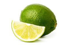 Green lime tree and slice on a white, isolated. Green lime tree and slice on a white background, isolated royalty free stock photography