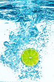 Green lime in the Water. Royalty Free Stock Images